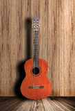 Guitar. Acoustic guitar with wooden background Stock Photos