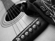 Guitar. And bandana, in black and white Royalty Free Stock Photography