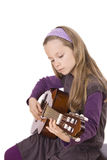 Guitar. A girl is playing guitar Royalty Free Stock Photo