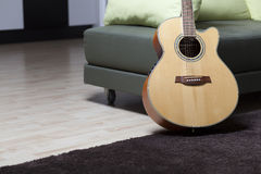 Guitar. An acoustic guitar standing on the floor Stock Photography