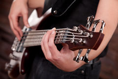 Guitar. Detail of a man playing a Guitar. With the focus on the hand in the foreground Royalty Free Stock Image