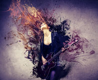 Guitar. Young beautiful woman playing guitar Stock Photography