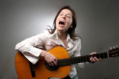 Guitar. A pretty woman play guitar Royalty Free Stock Image