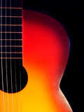 Guitar. Red guitar isolated on the black background stock photography