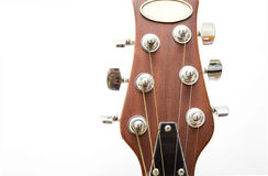 Guitar. Acoustic guitar cord holder on white Stock Photography