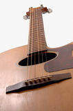 Guitar. Close up angle the top of an acoustic guitar Moderate DOF with the sharpest focus on the tuning peg royalty free stock image