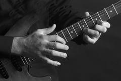 Guitar. Playing the guitar Stock Photo