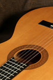 Guitar. Classical guitar detail on dark background Royalty Free Stock Images