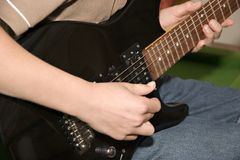 Guitar. Playing the guitar Royalty Free Stock Photography