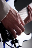 Guitar. Detail of mans hands playing electric guitar Royalty Free Stock Photos