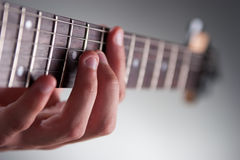 Guitar. Detail of mans hands playing electric guitar Royalty Free Stock Photography