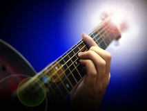 Guitar. Playing guitar with fingers on a dark blue background
