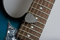 Guitar. Electric guitar on neutral gray background Royalty Free Stock Photography
