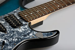 Guitar. Electric guitar on neutral gray background Royalty Free Stock Image