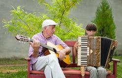 Guitar and accordion Stock Photos