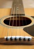 Guitar Acoustic. Western acoustic guitar closeup light wood Royalty Free Stock Photos