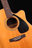 Guitar. Acoustic guitar on black background Royalty Free Stock Photos