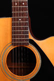 Guitar. Acoustic guitar on black background Stock Photos