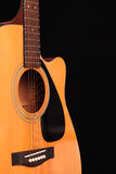 Guitar. Acoustic guitar on black background Stock Photography