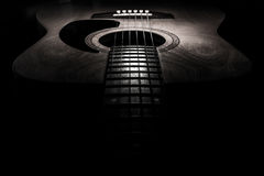 Guitar acoustic, ideal use for background. An idea for inspiration with low light Royalty Free Stock Photo