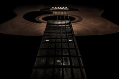 Guitar acoustic, ideal use for background. An idea for inspiration with low light Stock Photos