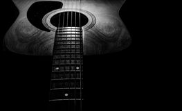 Guitar acoustic, ideal use for background. An idea for inspiration with low light Stock Photography