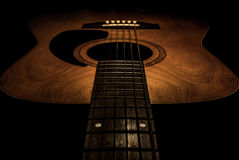 Guitar acoustic, ideal use for background. An idea for inspiration with low light Royalty Free Stock Photography