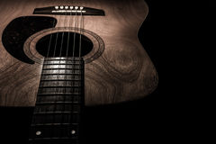 Guitar acoustic, ideal use for background. An idea for inspiration with low light Stock Photo