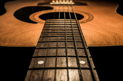 Guitar acoustic, ideal use for background. An idea for inspiration with low light Royalty Free Stock Images