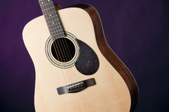 Guitar Acoustic Isolated on Purple Stock Image