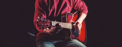 Guitar acoustic. Play the guitar. Live music. Music festival. Instrument on stage and band. Music concept. Electric royalty free stock images