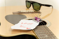 Guitar acoustic. Vintage style,Guitar acoustic and short note (i love you) on old wood background Stock Photography