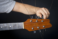 Guitar adjustment Royalty Free Stock Photos