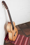 Guitar against a wall. A Guitar against a wall Stock Photography