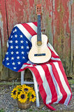 Guitar on American flag Stock Photography