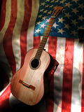 Guitar on american tour. A classic guitar, close to the flag of the United States, abstract presentation of a guitarist, or a band, tour through America stock illustration