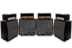 Guitar Amp Four. Four surrounding guitar amps in a pure white room royalty free stock images