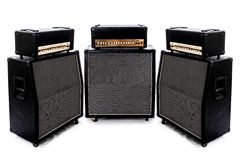 Guitar Amp Group of 3. Three surrounding guitar amps in a pure white room. Logo's have been removed stock photography