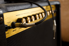 Guitar amplifier. Black cable plug in the guitar amplifier royalty free stock photography