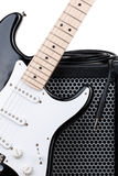 Guitar with amplifier and audio cord Royalty Free Stock Image