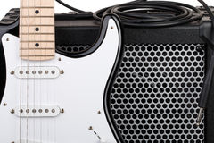 Guitar with amplifier and audio cord with jack closeup. Isolated on white background Stock Image