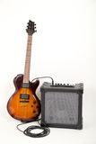 Guitar and amplifier with cable Stock Photo