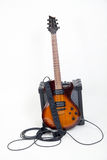 Guitar and amplifier with cable Royalty Free Stock Image