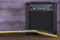 Guitar amplifier and electric guitar royalty free stock photo