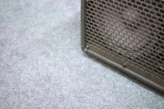 Guitar amplifier on grey carpet background with copy space royalty free stock photos