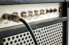 Guitar amplifier with jack cable. Close-up of guitar amplifier with jack cable Royalty Free Stock Images