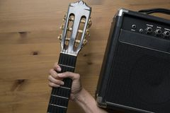 Guitar amplifier and woman hand holding a guitar Royalty Free Stock Images