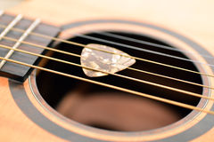 Guitar And Pick Stock Photo