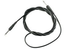 Guitar audio jack with black cable isolated on white background Royalty Free Stock Images