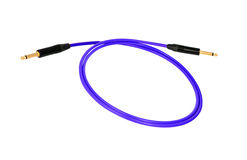 Guitar audio jack with blue cable isolated Royalty Free Stock Photos